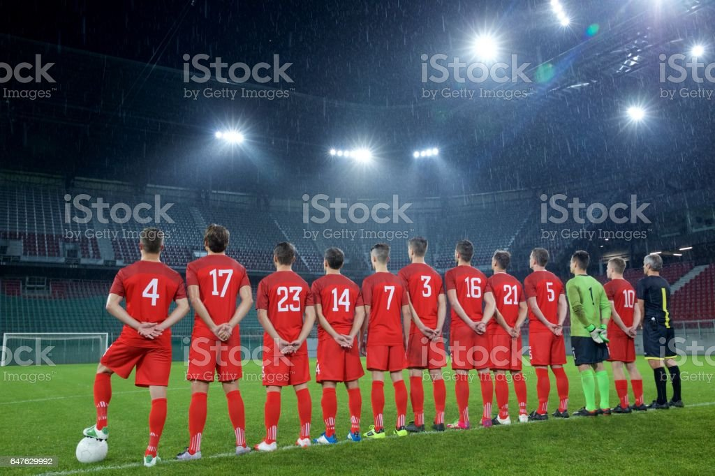 Football team standing in a row stock photo