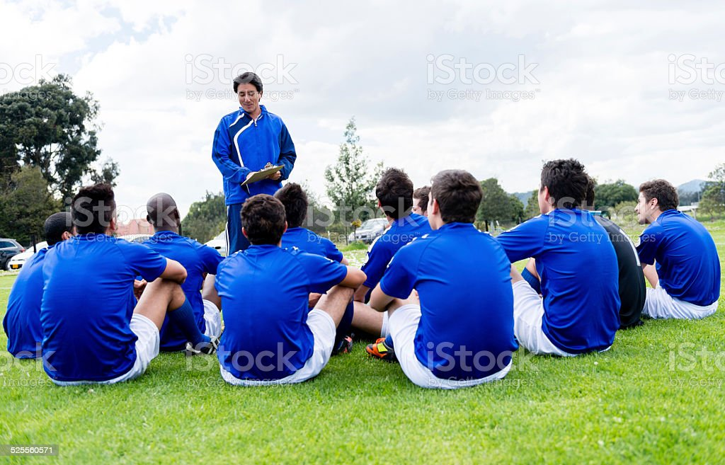 Football team with their coach stock photo