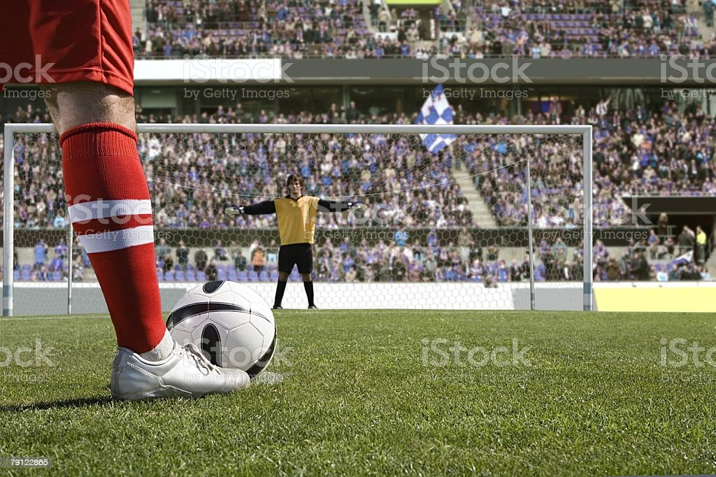 Footballer about to take a penalty stock photo