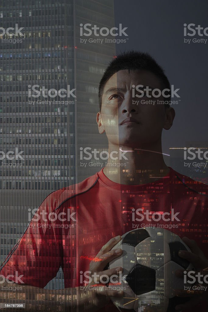 Footballer and cityscape, double exposure royalty-free stock photo