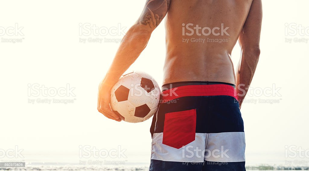 Footballer Ball Beach Back Facing Concept stock photo