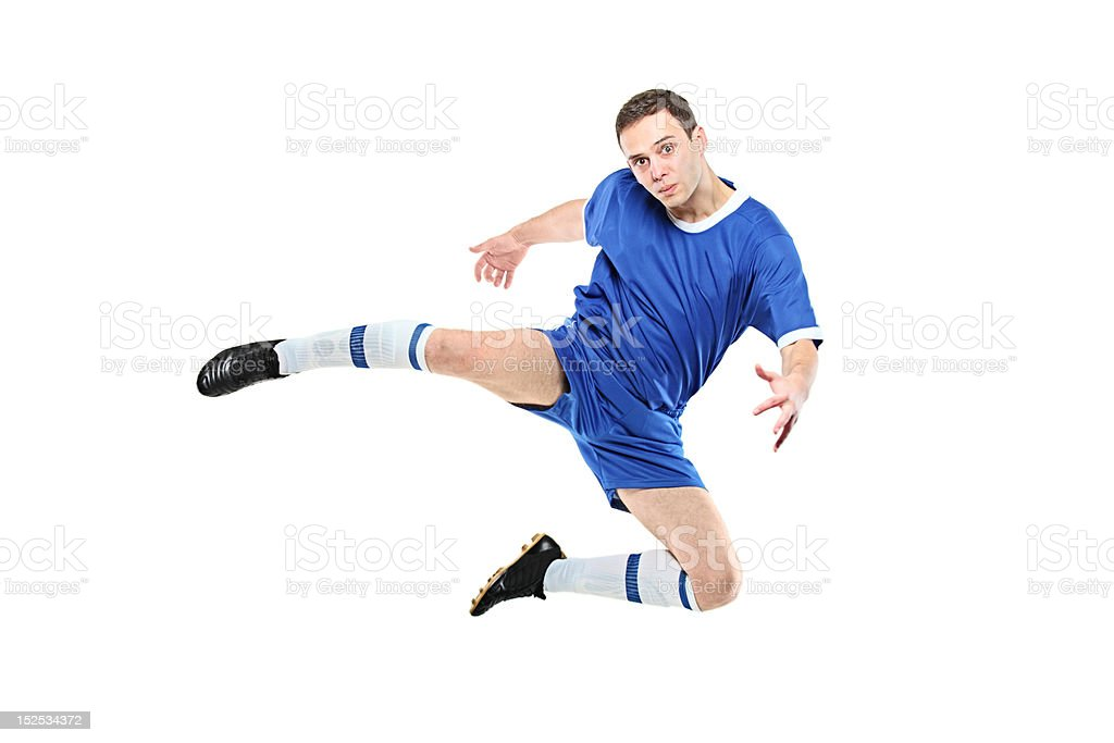 Footballer in a jump royalty-free stock photo