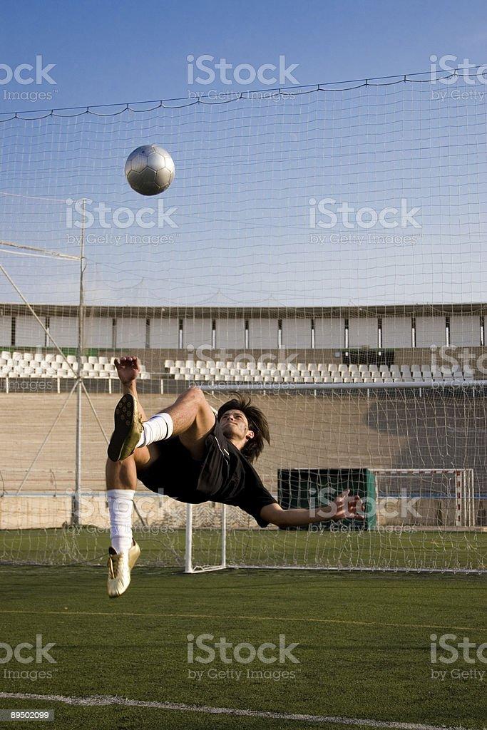 Footballer in action stock photo