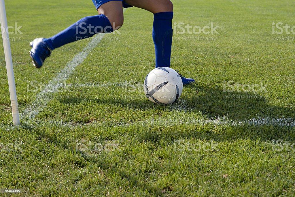 Footballer taking a corner kick royalty-free stock photo