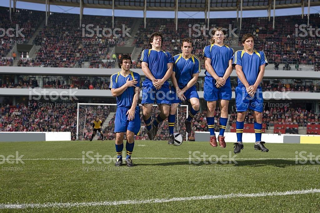 Footballers defending a free kick stock photo