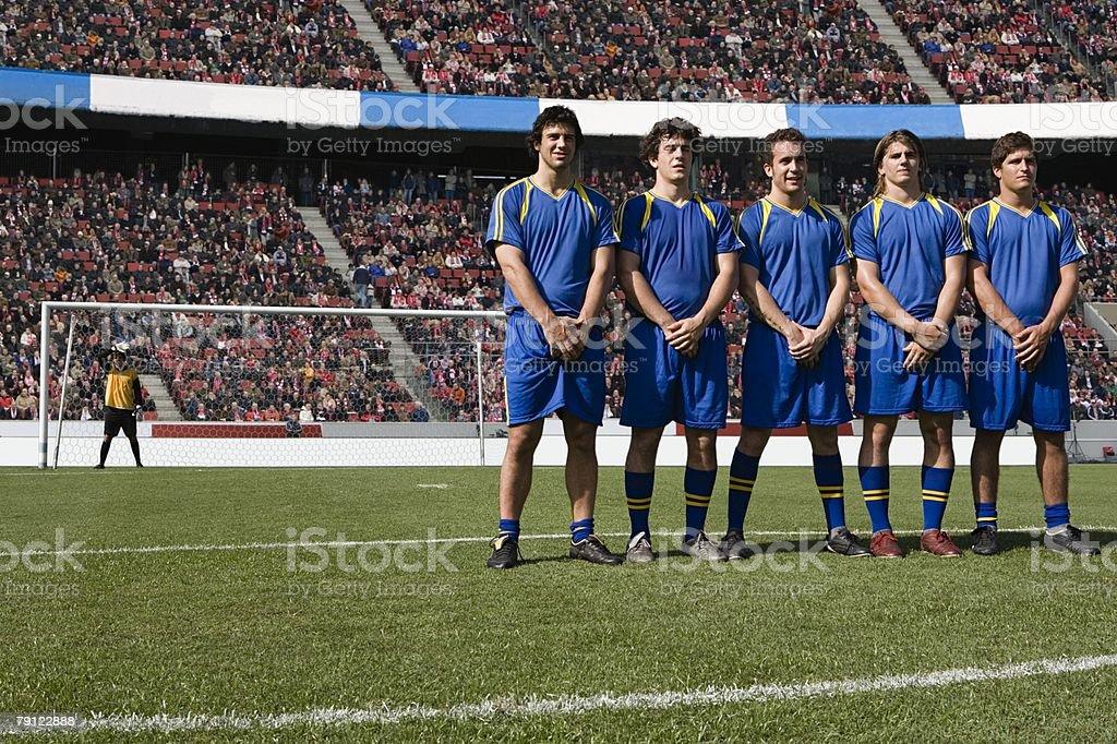 Footballers defending a free kick royalty-free stock photo