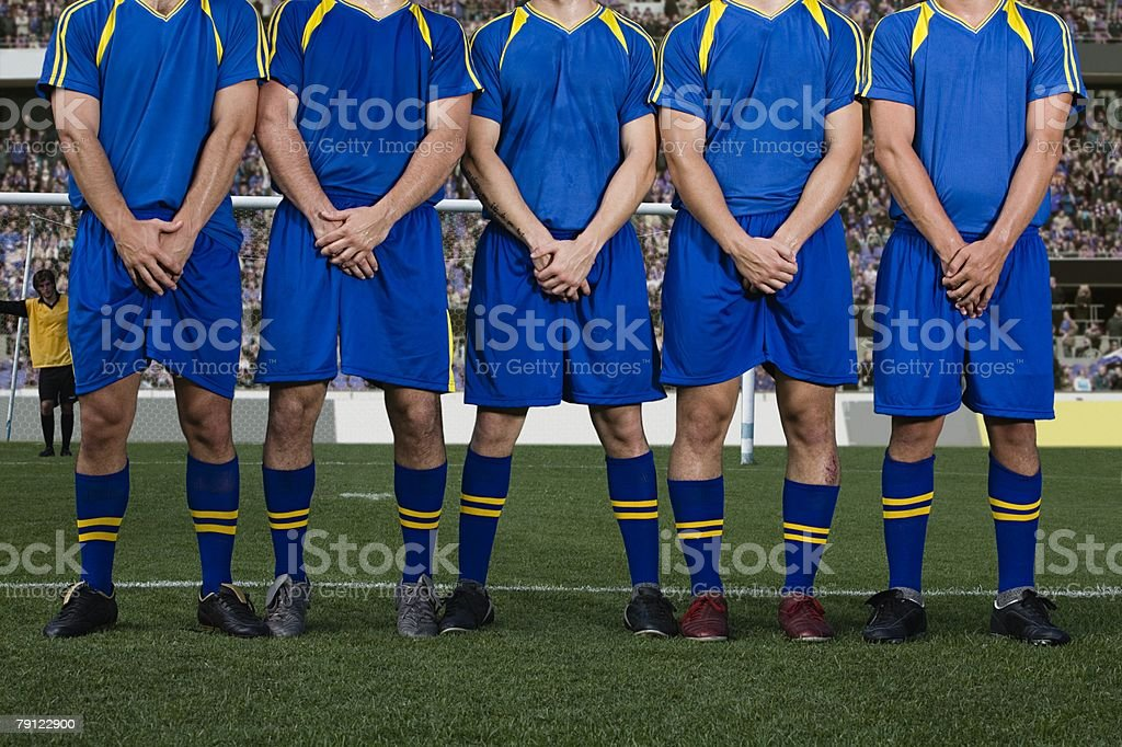 Footballers defending a free kick royalty-free stock photo