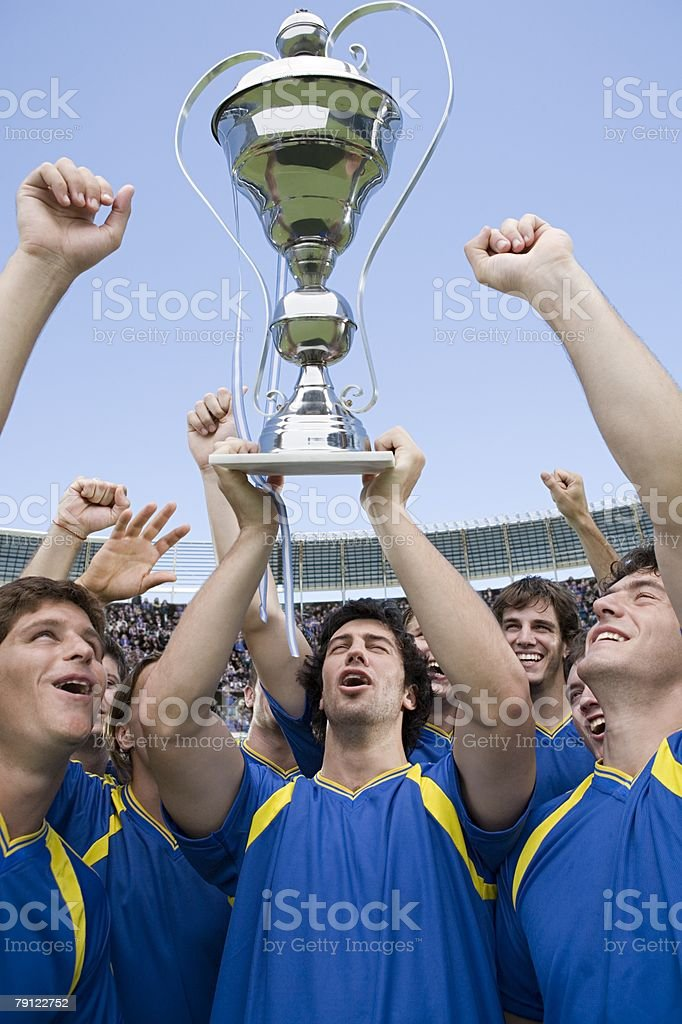 Footballers holding a trophy royalty-free stock photo