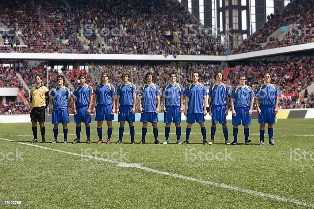Footballers in a row royalty-free stock photo