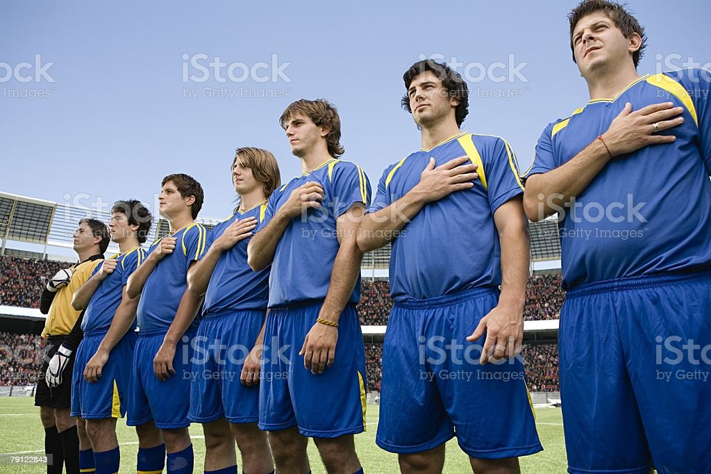 Footballers in a row stock photo