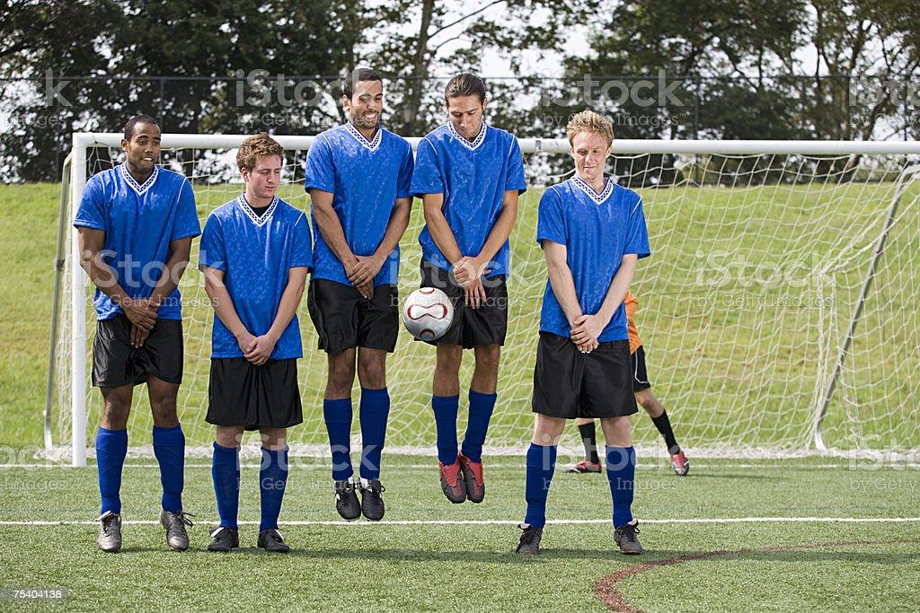 Footballers jumping stock photo