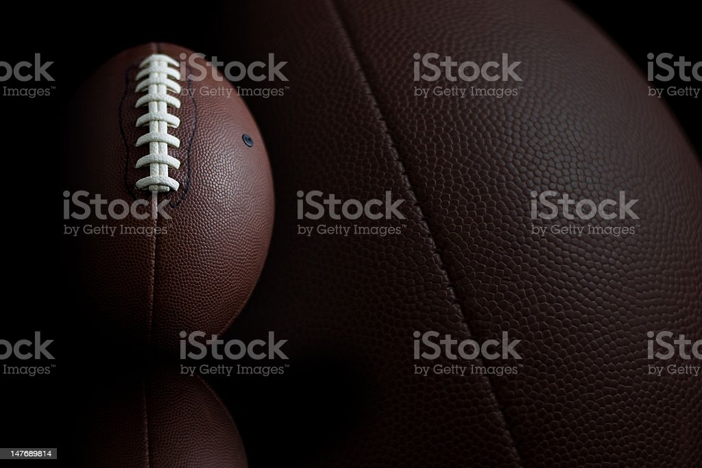 Football's on black royalty-free stock photo