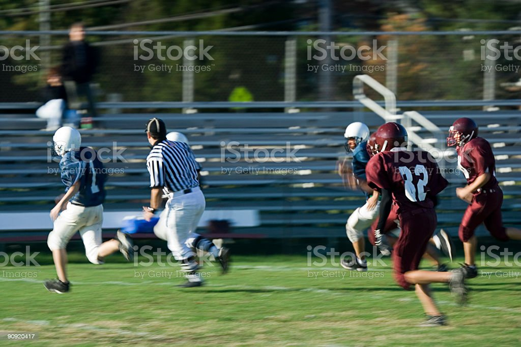 Footballs performing an American football game stock photo