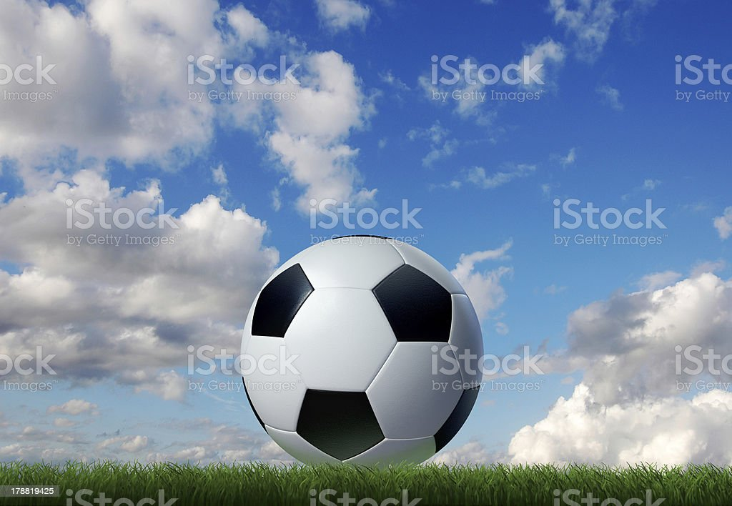 Football/soccer classic ball, on grass, with sky. royalty-free stock photo