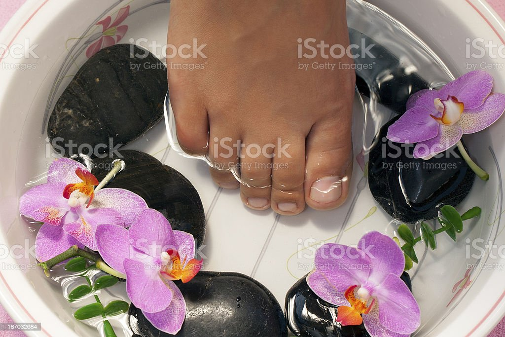 Footbath with orchids royalty-free stock photo