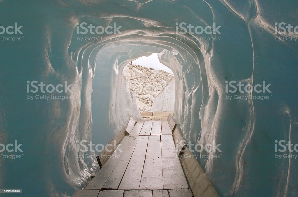Footbridge inside the ice cave (Eisgrotte am Rhonegletscher) royalty-free stock photo