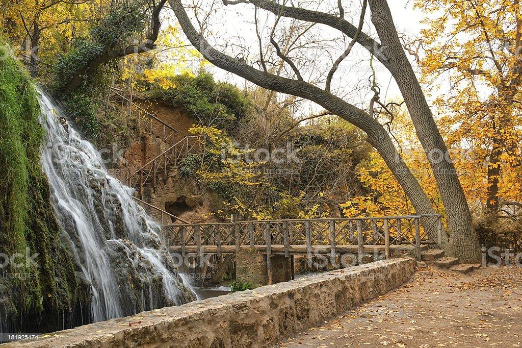 Footbridge near the waterfall stock photo