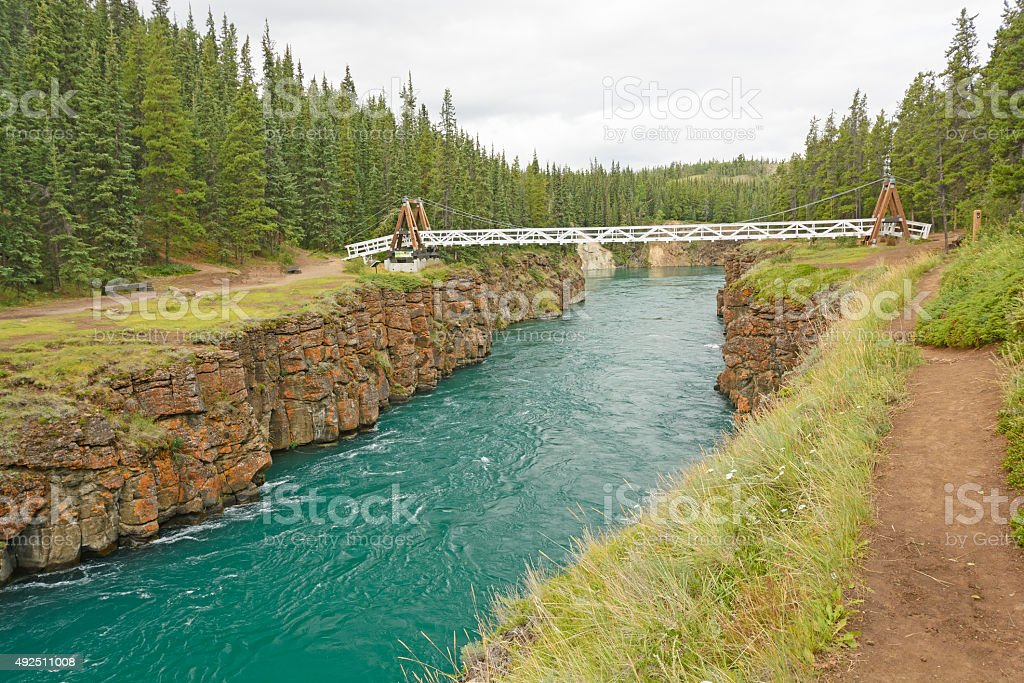 Footbridge over a River Canyon stock photo