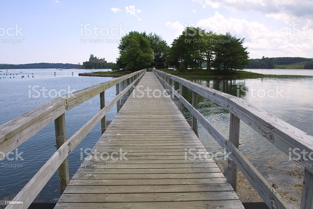 Footbridge over placid water royalty-free stock photo