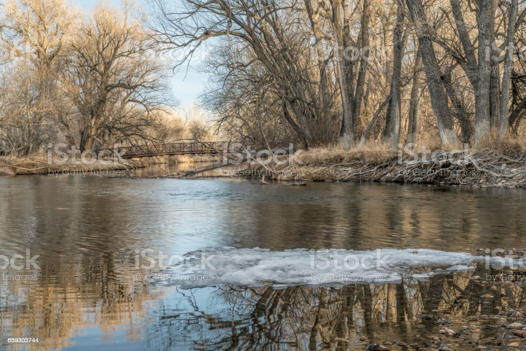 footbridge over Poudre River in Fort Collins stock photo