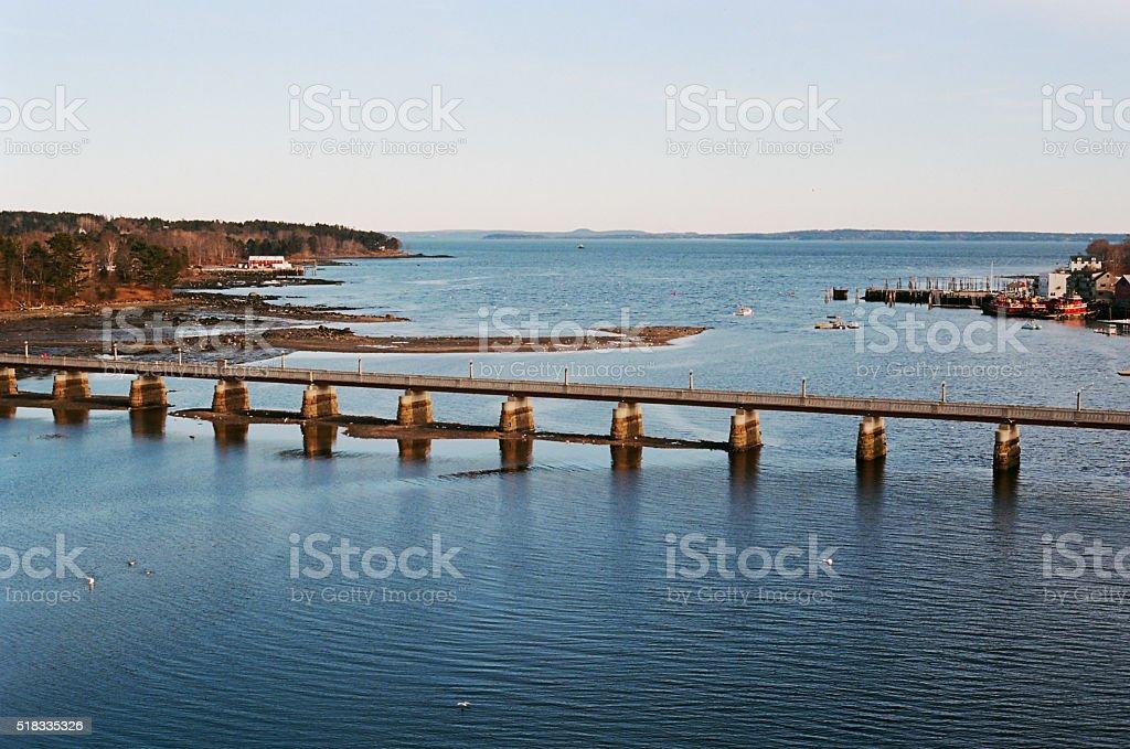 Footbridge spanning the Passagassakaweag River, Belfast Bay at lowtide stock photo