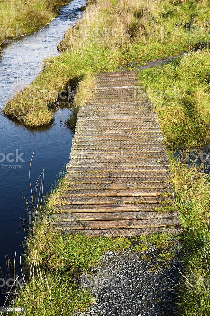 Footbridge to Eilean Mor Loch Finlaggan stock photo