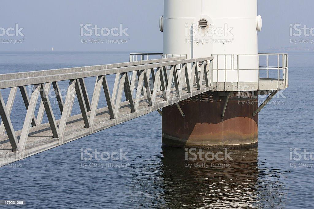 Footbridge to windmill stock photo