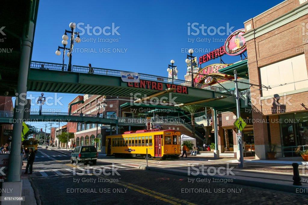 Footbridges to Centro Ybor entrance with yellow tram stock photo