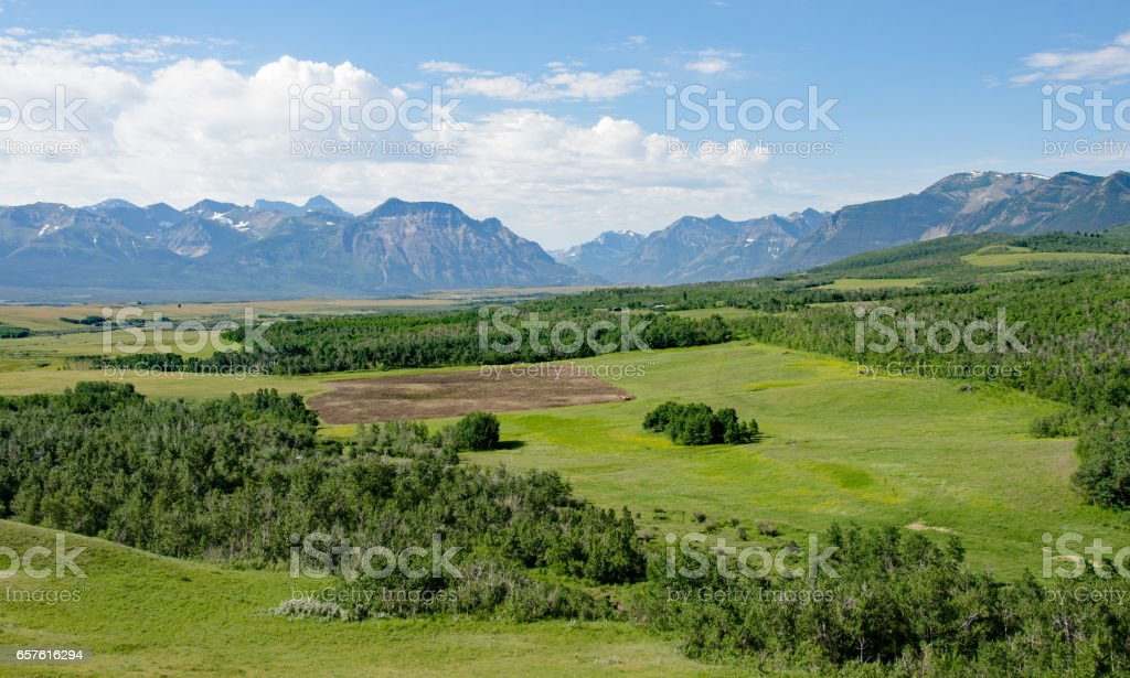 Foothills and grasslands of  Southern Alberta- Rocky Mountains in Background stock photo