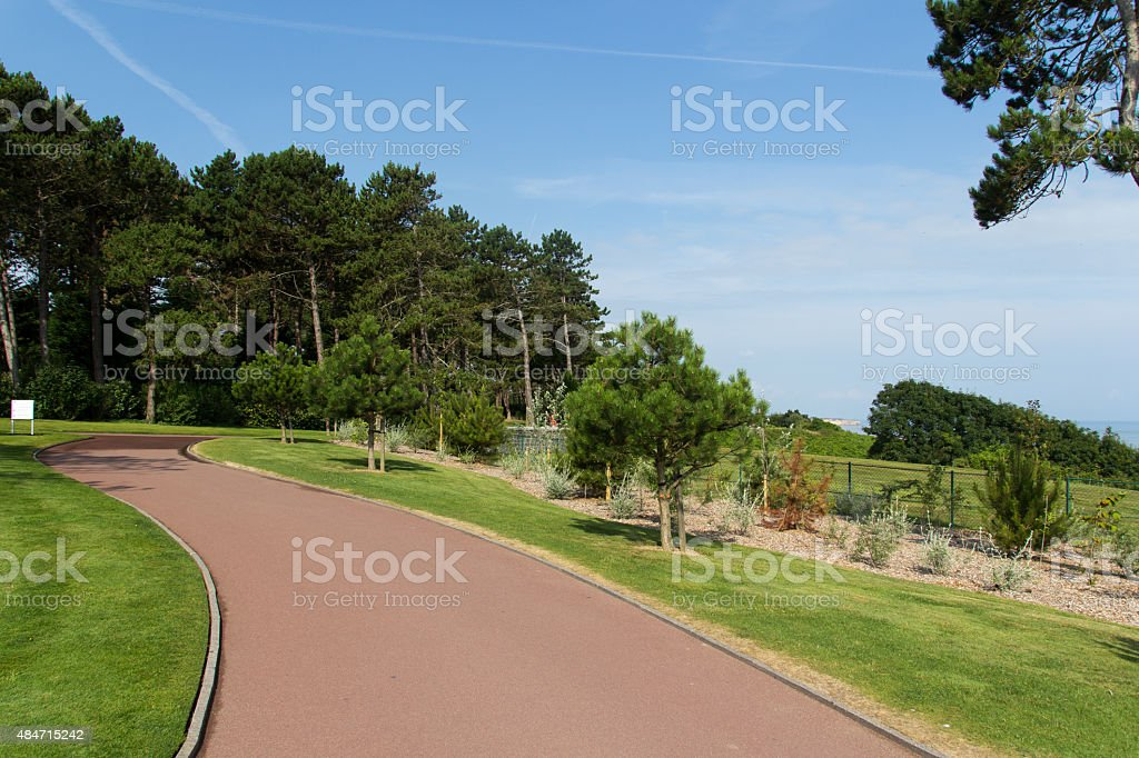 Footpath ay American War cemetery in Normandy - France. stock photo