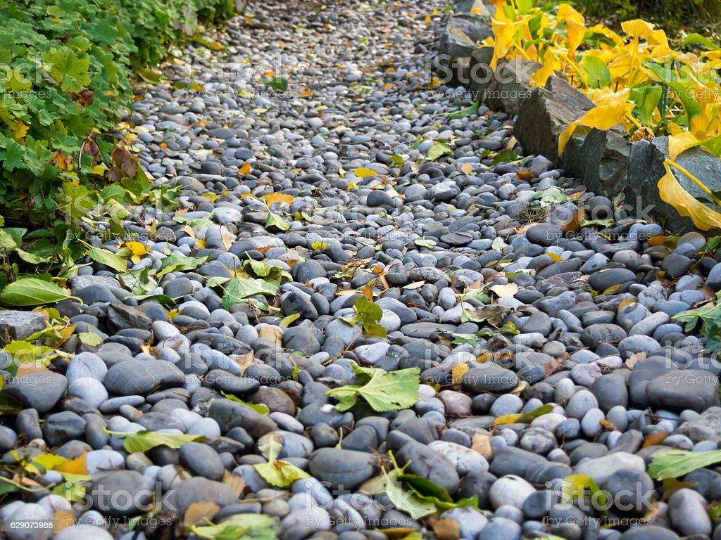 Footpath in autumn park, made of pebbles stock photo