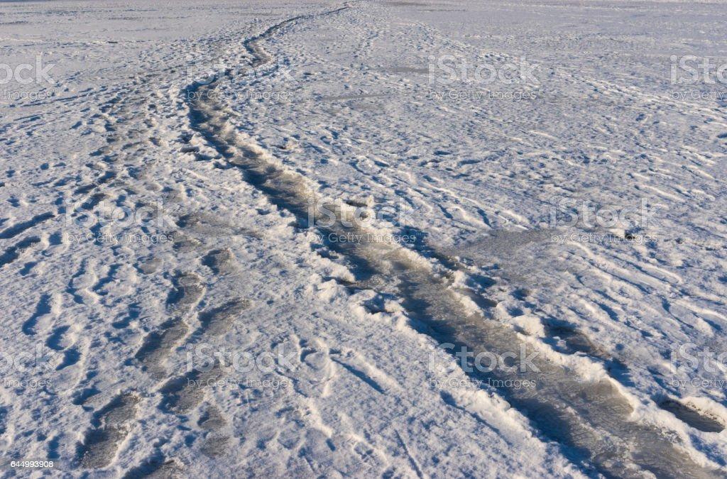 Foot-path on a frozen river Dnepr at winter season stock photo