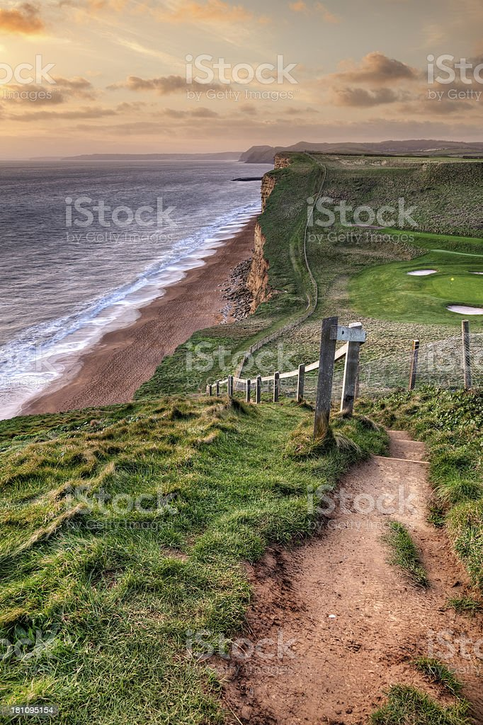 Footpath on the Dorset Jurassic Coast at sunset stock photo