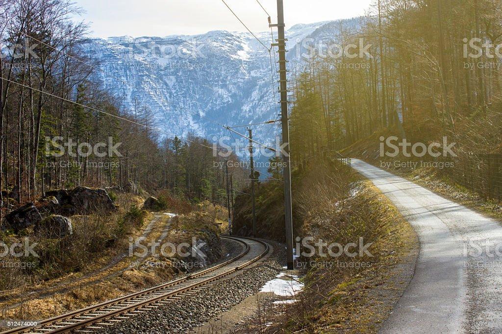 Footpath, railroad track covered Austrian alps in Hallstatt stock photo