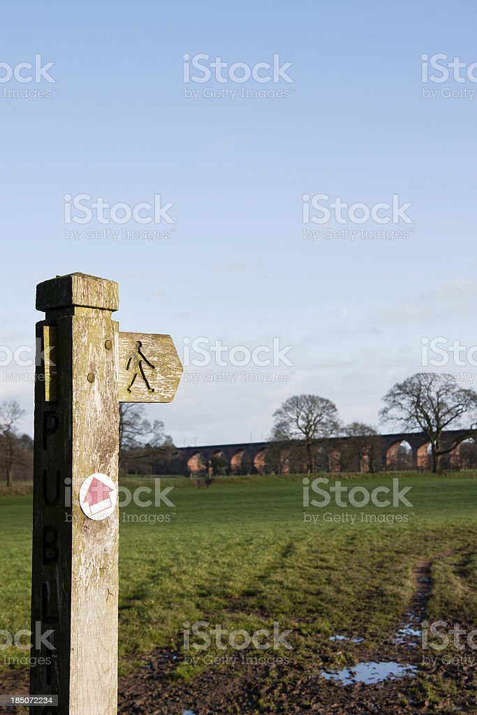 Footpath Signpost with Viaduct in the background royalty-free stock photo