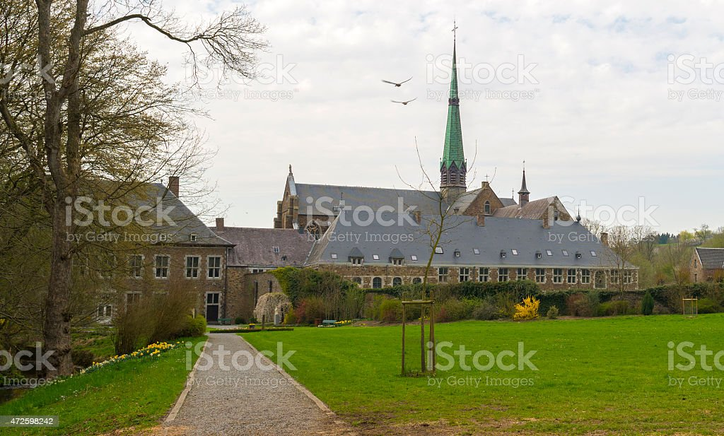 Footpath through the park of an abbey in spring stock photo