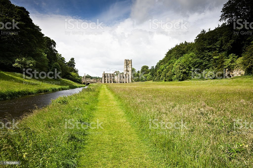 Footpath to Ruined Abbey and River stock photo