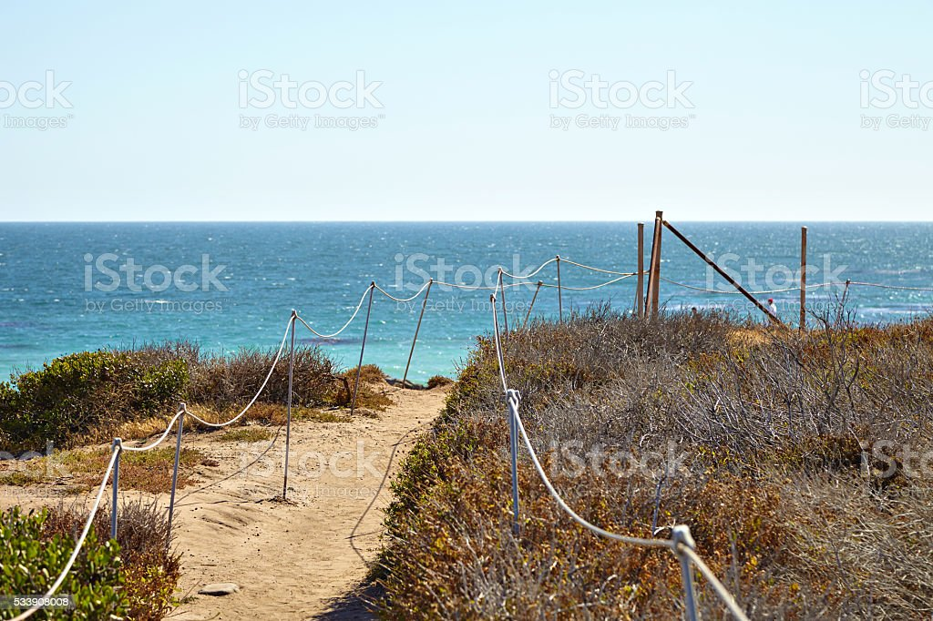 Footpath to the malibu beach stock photo
