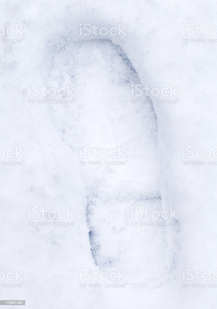 Footprint in fresh soft snow stock photo