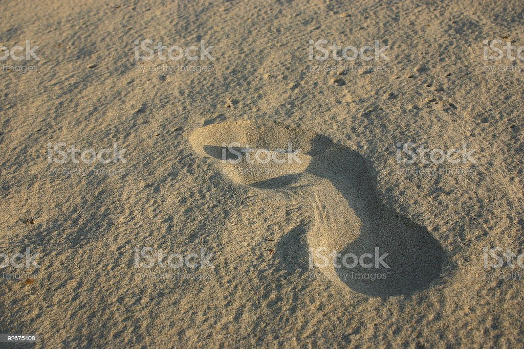 footprint in sand stock photo