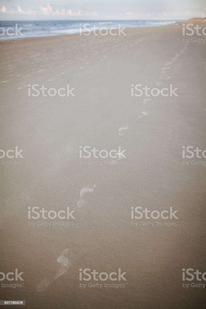 Footprint in the sand at beach stock photo