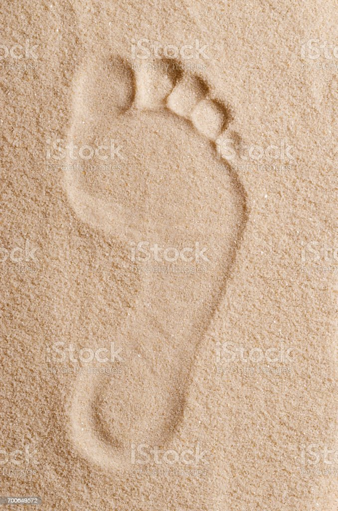 Footprint in the sand macro photo stock photo