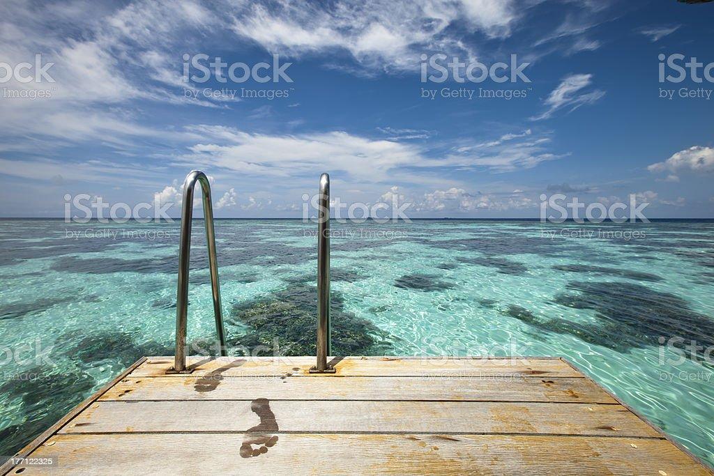 Footprint on pontoon royalty-free stock photo