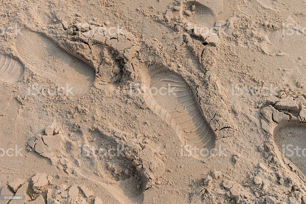 Footprint on sand near the beach in sunset time stock photo