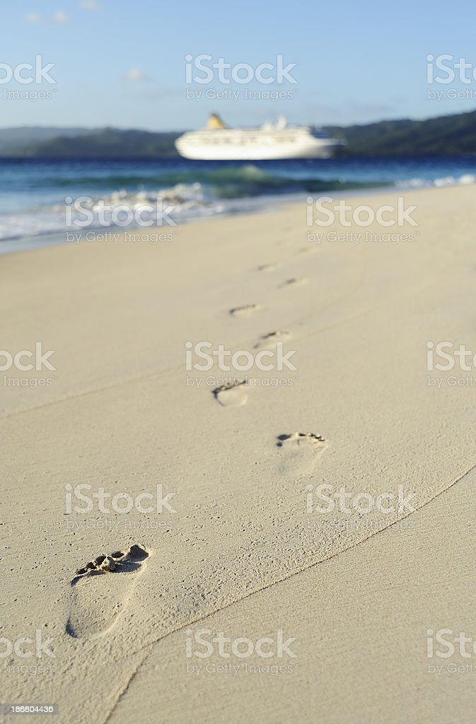 Footprints and cruise ship royalty-free stock photo