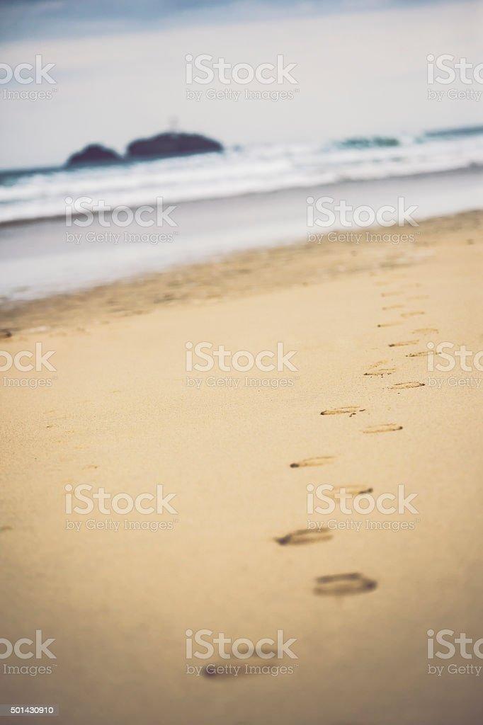 Footprints at Godrevy Lighthouse, Cornwall stock photo
