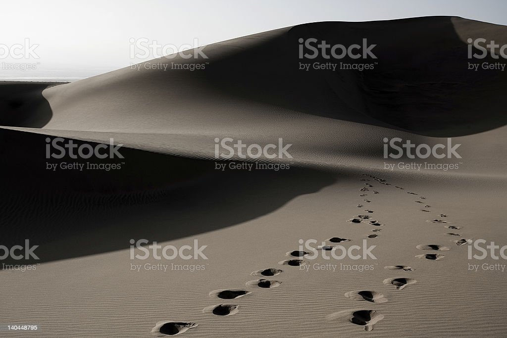 footprints in dunes royalty-free stock photo