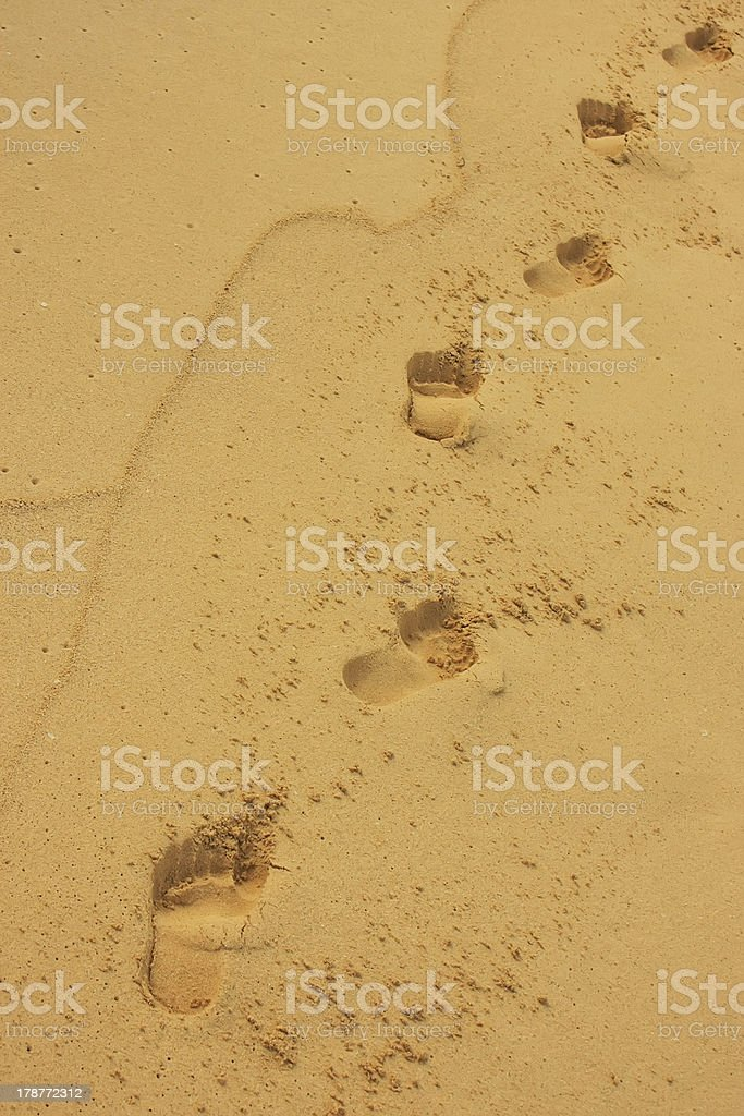 Footprints in sand royalty-free stock photo