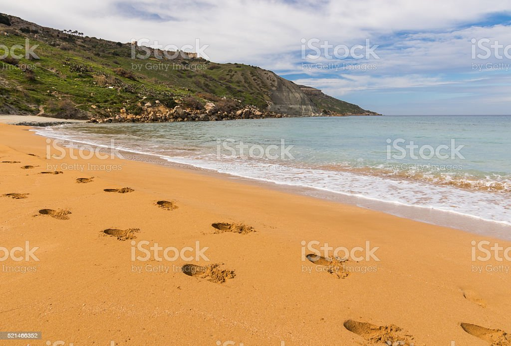 Footprints in sand - Ramla Bay, Malta stock photo