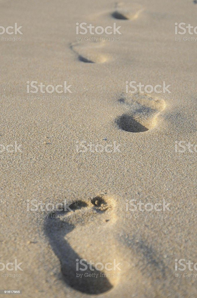 Footprints in the sand on beach Lagos, Portugal. royalty-free stock photo